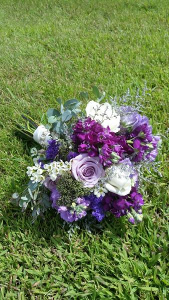 [Image: Shades of purple, roses, stock, trachillium, lisianthus, eucalyptus, statice and waxflower.]
