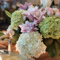 Lush hydrangea, double oriental lilies and ranunculus in shades of pinks and lime green.