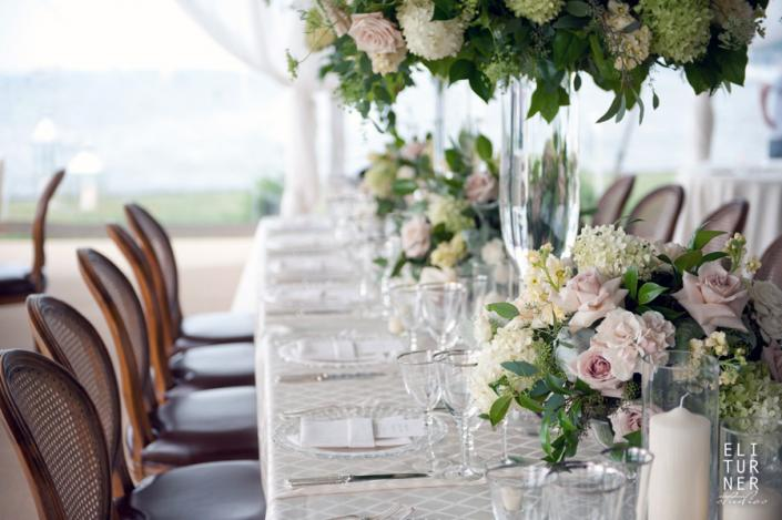 [Image: Beautiful, soft bouquets line this table with roses, hydrangea and lush greenery.]