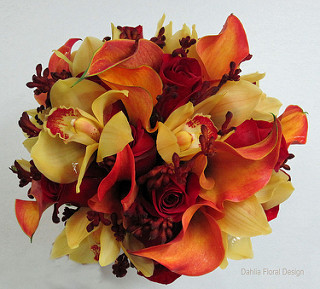 This unique bouquet was designed with orange miniature calla lilies, yellow cymbidium orchids, kangaroo paws and roses.