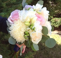 [Image: Roses, standard mums, freesia, seeded eucalyptus]