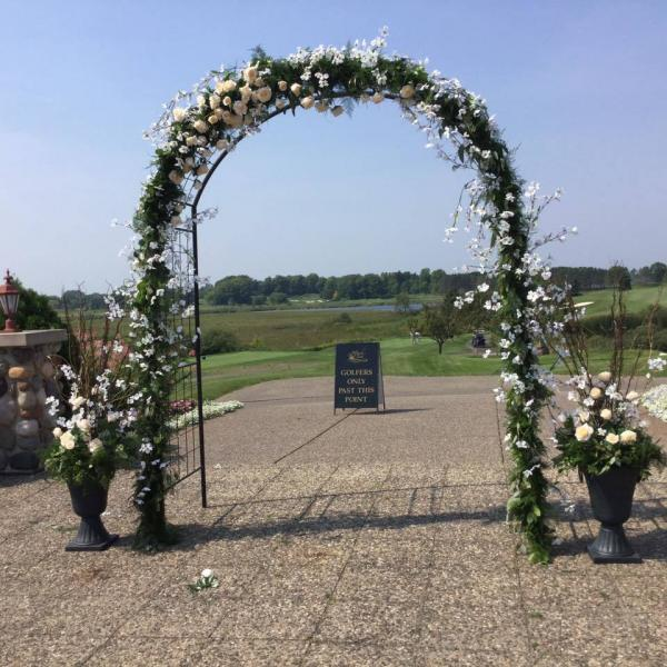[Image:  Fresh green garland designed with all faux champagne and ivory flowers. Designed at Rush Creek Golf Course in Maple Grove MN.]