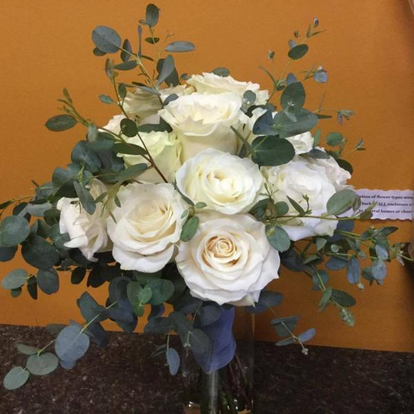 Beautiful white roses with a variety of eucalyptus.