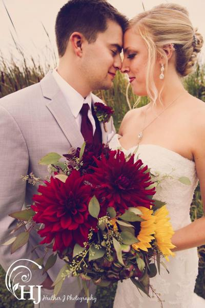 [Image: Beautiful fall wedding with locally grown deep red dahlias, sunflowers, antique hydrangea, sunflowers and seeded eucalyptus.]
