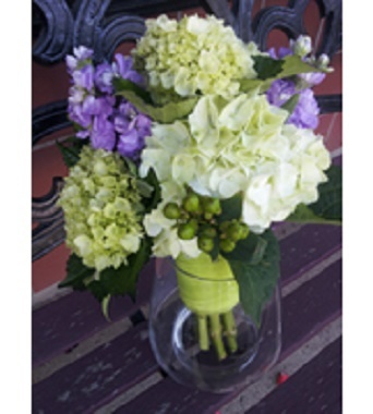 [Image: Lime green and white hydrangea, lavender stock and green hypericum berries.]