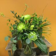 This bouquet designed in all green with spider mums, ferns, buplurem, hydrangea and silver dollar eucalyptus.