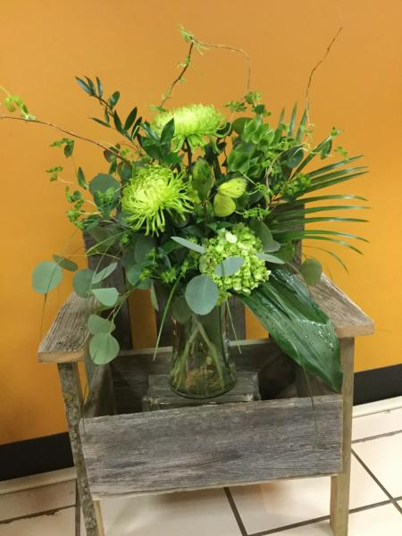 [Image: This bouquet designed in all green with spider mums, ferns, buplurem, hydrangea and silver dollar eucalyptus.]
