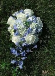 Fragrant white roses with blue hydrangea and delphinium