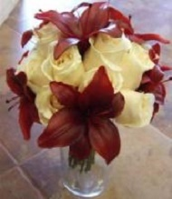 Ivory roses, dark red asiatic lilies.