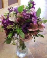 Antique lavender roses, dark and light purple stock, seeded eucalyptus.