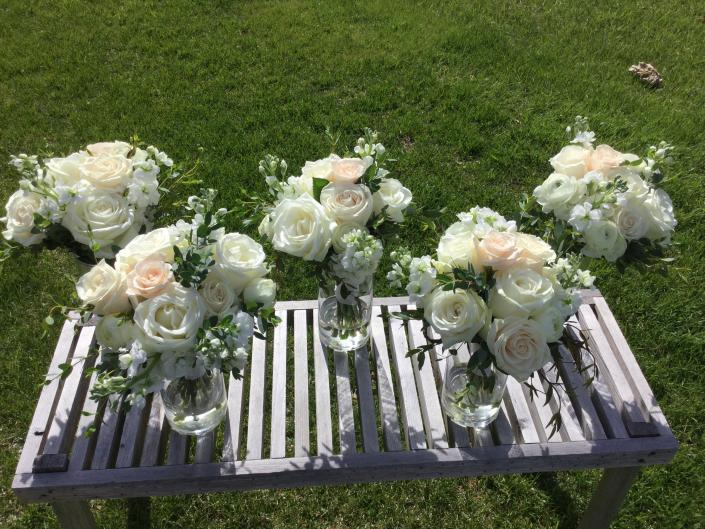 [Image: Ivory and champagne roses, stock and greenery.]