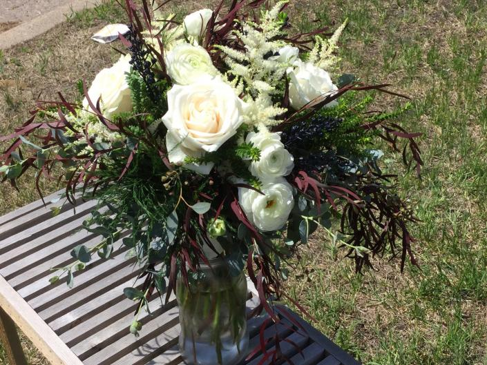 [Image: White roses and ranunculus, astilbe and a variety of eucalyptus.]