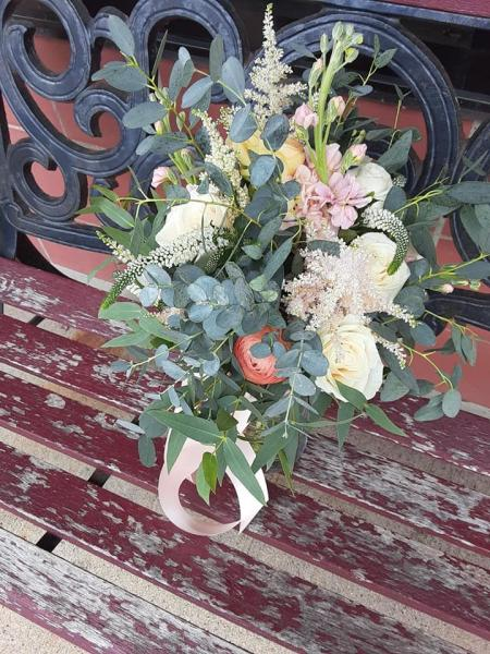 This bouquet was designed with peach ranunculus, ivory veronica, champagne roses, light pink astilbe and a variety of eucalyptus, very romantic!