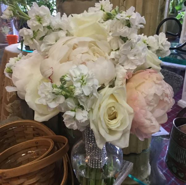 [Image: Blush and ivory peony's, white fragrant stock and ivory roses.]