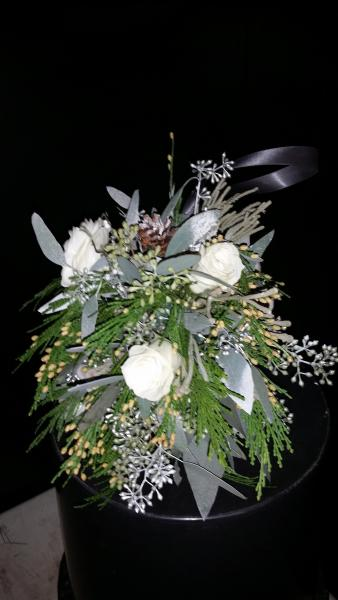 Fragrant cedar with miniature roses, seeded eucalyptus and mini natural pinecones.